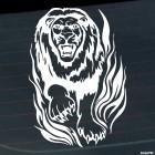 Наклейка лев идет через пламя флэймз